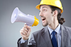 Man shouting   with loudspeaker Stock Photo