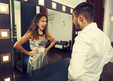 Man shouting at mad woman in the mirror. Angry men shouting at mad women in the mirror Royalty Free Stock Images