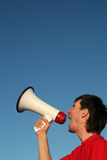 Man Shouting Through Megaphone. Young Man Shouting Through Megaphone Royalty Free Stock Image