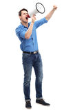 Man shouting through megaphone. Young man over white background Stock Photo