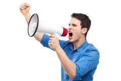 Man shouting through megaphone. Young man over white background Stock Image