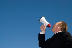 Man shouting through megaphone. Royalty Free Stock Photo