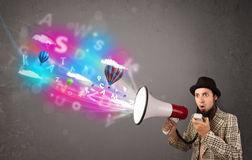Man shouting into megaphone and abstract text and balloons come Royalty Free Stock Image
