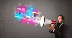 Man shouting into megaphone and abstract text and balloons come Stock Images