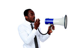 Man shouting through a megaphone Royalty Free Stock Photo