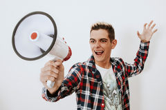 Man shouting with megaphone Stock Images
