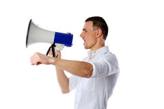 Man shouting through megaphone. Over white background Stock Photography