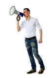 Man shouting through megaphone. Over white background Royalty Free Stock Photography