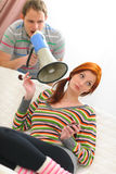 Man shouting through megaphone to girlfriend Stock Images