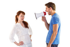 Man shouting through a megaphone Stock Photo
