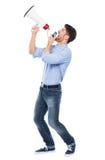 Man shouting through megaphone Royalty Free Stock Image
