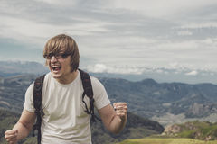 Man shouting at the mountain top Royalty Free Stock Photo