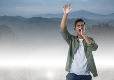 Man shouting in mountains Royalty Free Stock Photography