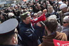 The man is shouting at the mouthpiece for protest actions royalty free stock photography