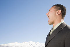 Man shouting near mountains Royalty Free Stock Photos