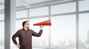 Man shouting in pape cone Stock Images