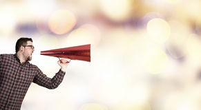 Man shouting in pape cone . Mixed media Royalty Free Stock Photos