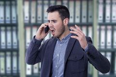 Man shouting by the phone Stock Photos