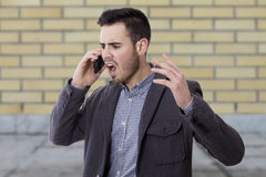 Man shouting by the phone Royalty Free Stock Photo