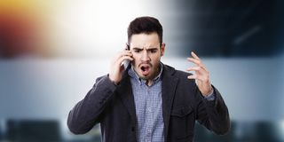 Man shouting by the phone. Mobile Stock Photo