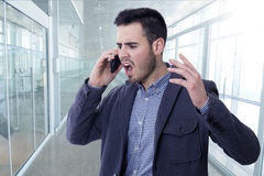 Man shouting by the phone. Mobile Royalty Free Stock Photos