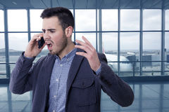 Man shouting by the phone Stock Photography