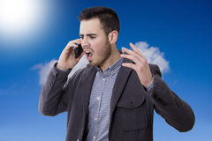 Man shouting by the phone. Mobile Stock Image