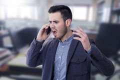 Man shouting by the phone. Mobile Royalty Free Stock Image