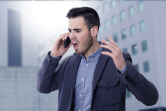 Man shouting by the phone. Mobile Royalty Free Stock Photo