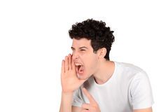 Man shouting. Portrait of a young man shouting. Isolated white background Stock Photo