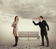 Man shouting at sad woman. Angry men shaking fist and shouting at sad woman Stock Photos