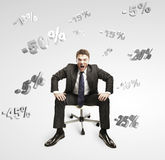 Man shouting and sitting under falling percents Stock Photo