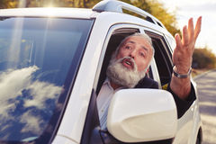 Man shouting from the window of his car Stock Photography