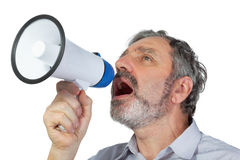 Man shouts into megaphone. An elderly man shouts into megaphone Stock Photography