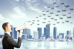 Man shouts yes on the city background, say yes concept Stock Image