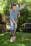 Man with shovel. Gardener in back yard with a shovel Royalty Free Stock Photography