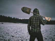 Man and shovel Royalty Free Stock Images