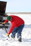 Man Shoveling. Out Stalled Truck royalty free stock images