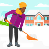 Man shoveling and removing snow. Royalty Free Stock Photo