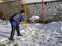 Man shoveling snow. Image of a man shoveling the snow Royalty Free Stock Images