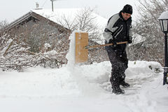 A man shoveling snow Stock Photos