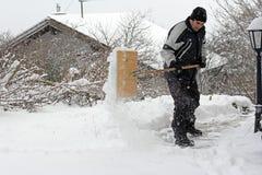 A man shoveling snow Stock Photos