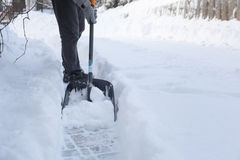 Man shoveling snow away from walkway Stock Images