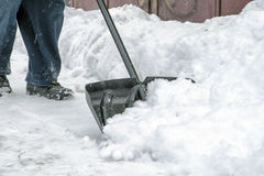 Man is shoveling snow Stock Photos