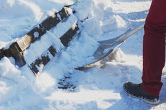Man shoveling snow close up. Man cleaning snow from sidewalk in front of house. Royalty Free Stock Photo