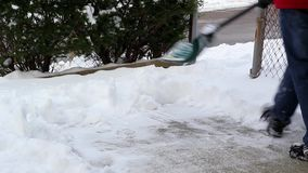 Man Shoveling Snow stock video footage