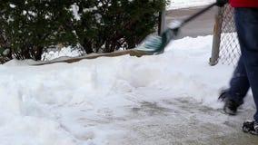 Man Shoveling Snow stock video footage