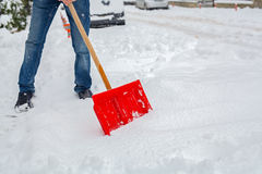 Man shoveling snow on road Stock Photography