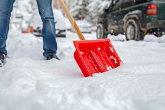 Man shoveling snow on road Royalty Free Stock Images