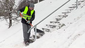 Man shoveling snow on stairs stock video